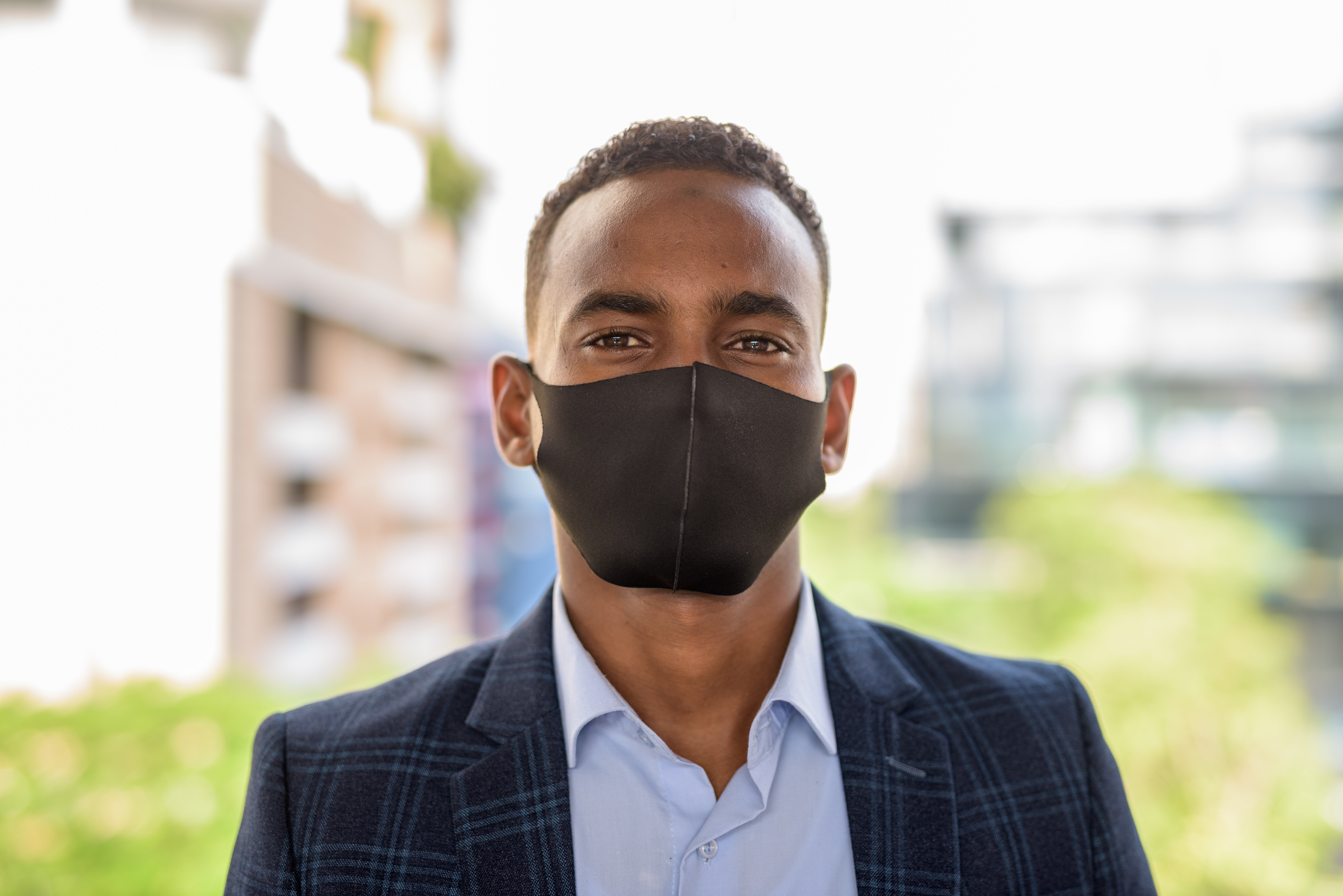 face-of-young-african-businessman-wearing-mask-for-GLA5NSG